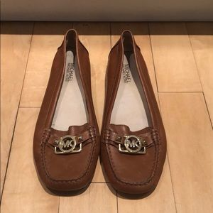 Chestnut colored Michael Khors leather loafers.